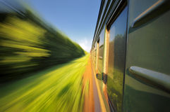 Fast riding a train with motion blur Royalty Free Stock Photography