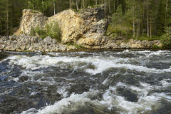 Fast river with stone banks Royalty Free Stock Photos