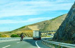 Fast road in the mountains in Spain, beautiful landscape of moun. Tains, dry earth and rock from the sun, transportation Stock Photos