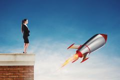Fast rocket ready to fly fast. Startup of a new company concept royalty free stock photo