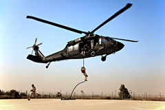Fast roping down a Blackhawk stock photos