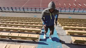 Fast running athlete. A black man is training on the steps in the stadium. stock video