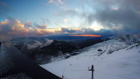 Fast running clouds over Low Tatras with magic sunset. Chopok mountain 2024 meters stock video footage