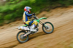 Fast running racer at motocross Royalty Free Stock Photos