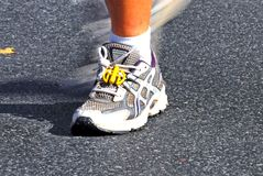 Fast running shoes. A runner at the berlin marathon Stock Images
