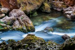 Free Fast Running Water And Eroded Rocks At Fontaine De Vaucluse, River Sourgue., Provence , France Stock Photography - 180138462