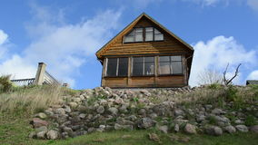 Fast rural wooden summer house stone hill cloud flow blue sky stock video footage