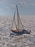 Fast Sailing Boat racing in Stormy Weather in the Netherlands Stock Image