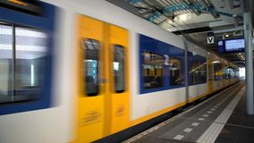 SBB train in the station. Fast SBB train with blue and white strip style in the station, Netherlands stock video