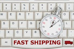 Stopwatch on a keyboard with text Fast Shipping and a truck stock images