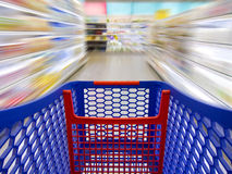 Fast shopping. Trolley over a blurred background in a supermarket as a concept of fast shopping Royalty Free Stock Photography