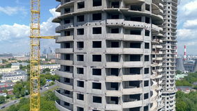Fast shot of an unfinished rounded tower block from first floor to the roof. 4K. stock video