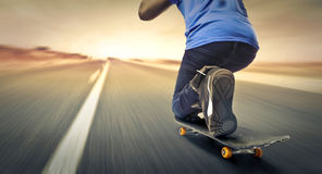 Fast skateboard. Man on a fast skateboard Royalty Free Stock Photos