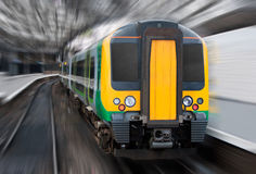 Fast Speed Train with Radial Blur. Commuter. Modern Passenger Speed Commuter Transport Train in the Station with Motion Radial Zoom Blur Stock Image