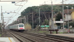 Fast speed White Train Passing From the Station. Trenitalia Etr 460 Electric Train stock video
