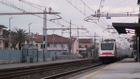 Fast speed White Train Passing From the Station. Trenitalia Etr 460 train Transit stock footage