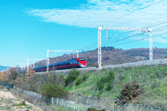 Fast speeding up train in countryside railway Stock Image