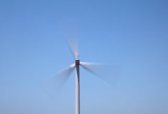 Fast spinning wind turbine Royalty Free Stock Images
