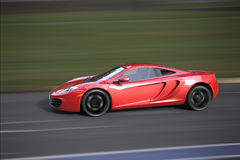 Fast sportcar on a track Stock Images