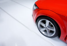 Fast sports car moving with blur. Fast sports car moving with motion blur and zooming effect royalty free stock images
