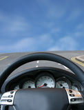 Fast sports car - steering wheel Stock Images
