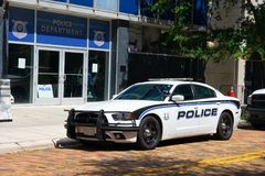 Fast sporty cop car in front of Police Department station house stock photography