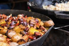 Pork sausages and Vegetables in pan. Tradition czech street food on market stock image