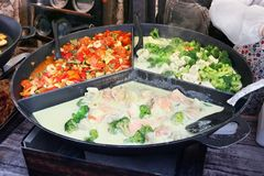 Fast street food - salmon stakes  in creamy sauce with red papri Stock Photo