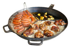 Fast street-food - smoked pork sausages, chicken legs  and stewe Royalty Free Stock Images