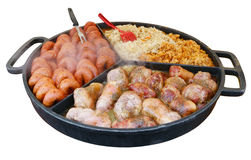 Fast street-food - smoked pork sausages and stewed cabbage in bi Stock Photos