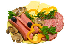 Fast, tasty snack.. Sausage with vegetables and cheese Royalty Free Stock Images