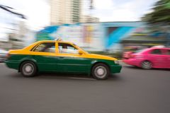 Fast taxi in city traffic Stock Photography