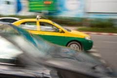 Fast taxi in city traffic Stock Image