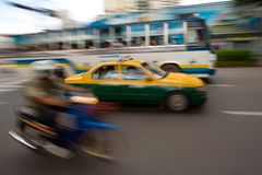 Fast taxi in city traffic Royalty Free Stock Photos