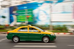 Fast taxi in city traffic Stock Images