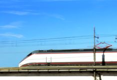 Fast train. Train running under blue sky Royalty Free Stock Image