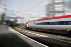 Fast train. Fast speeding train through station Stock Photography