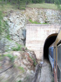 Fast train. Entering a tunnel, photo taken from the train Stock Image