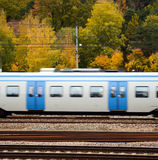 Fast train against Autumn forest Stock Image