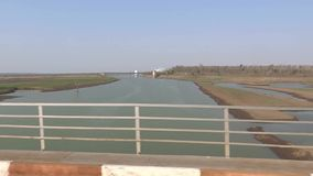 Fast Train Crossing A Rive. A Fast Train Crossing A River bridge stock video footage