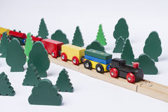 Fast train driving through small forest Stock Photos