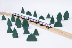 Fast train driving through small forest Royalty Free Stock Images