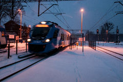 Fast train in the late evening Royalty Free Stock Photo