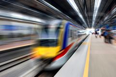 Fast train leaving station Royalty Free Stock Images