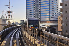 Fast Train ( Light Rail Transport ). A light rail train (LRT) is moving from Shinbashi to Odaiba, Tokyo, Japan Royalty Free Stock Image