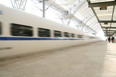 Fast train in motion. Fast train with motion blur in China Royalty Free Stock Image