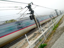 Fast Train in Motion. Speedy train in blurriness motion Royalty Free Stock Photography