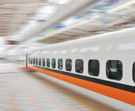 Fast train in motion. Fast train passing by with Motion blur Stock Photo