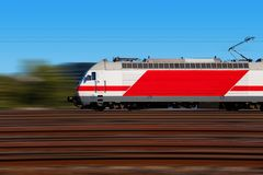 Fast train with motion blur. Modern high speed electric locomotive with motion blur effect Royalty Free Stock Images