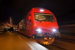 Fast train with motion blur. Night view of modern high-speed train with motion blur effect Stock Photography